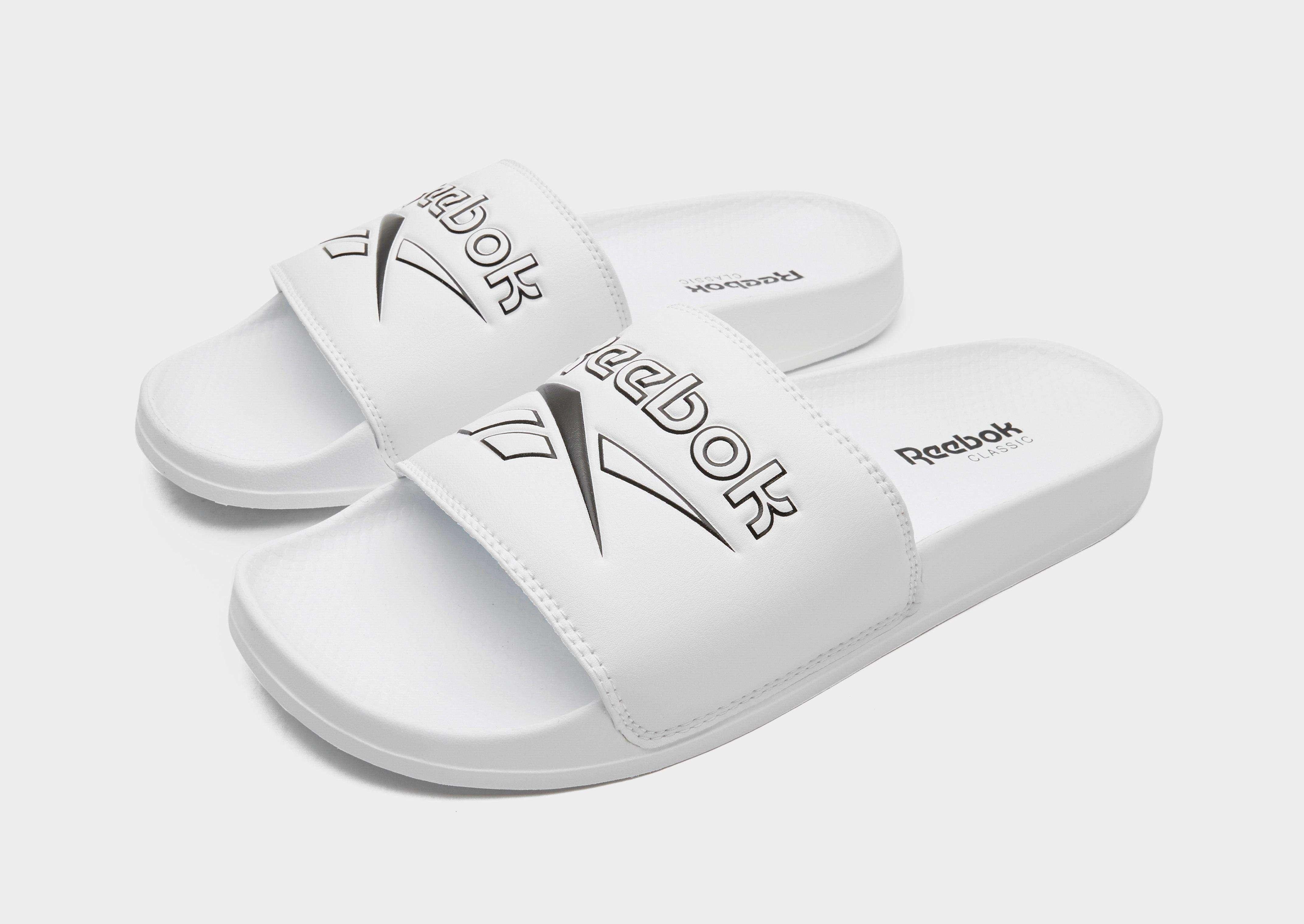 37772b793697a REEBOK Classic Slides