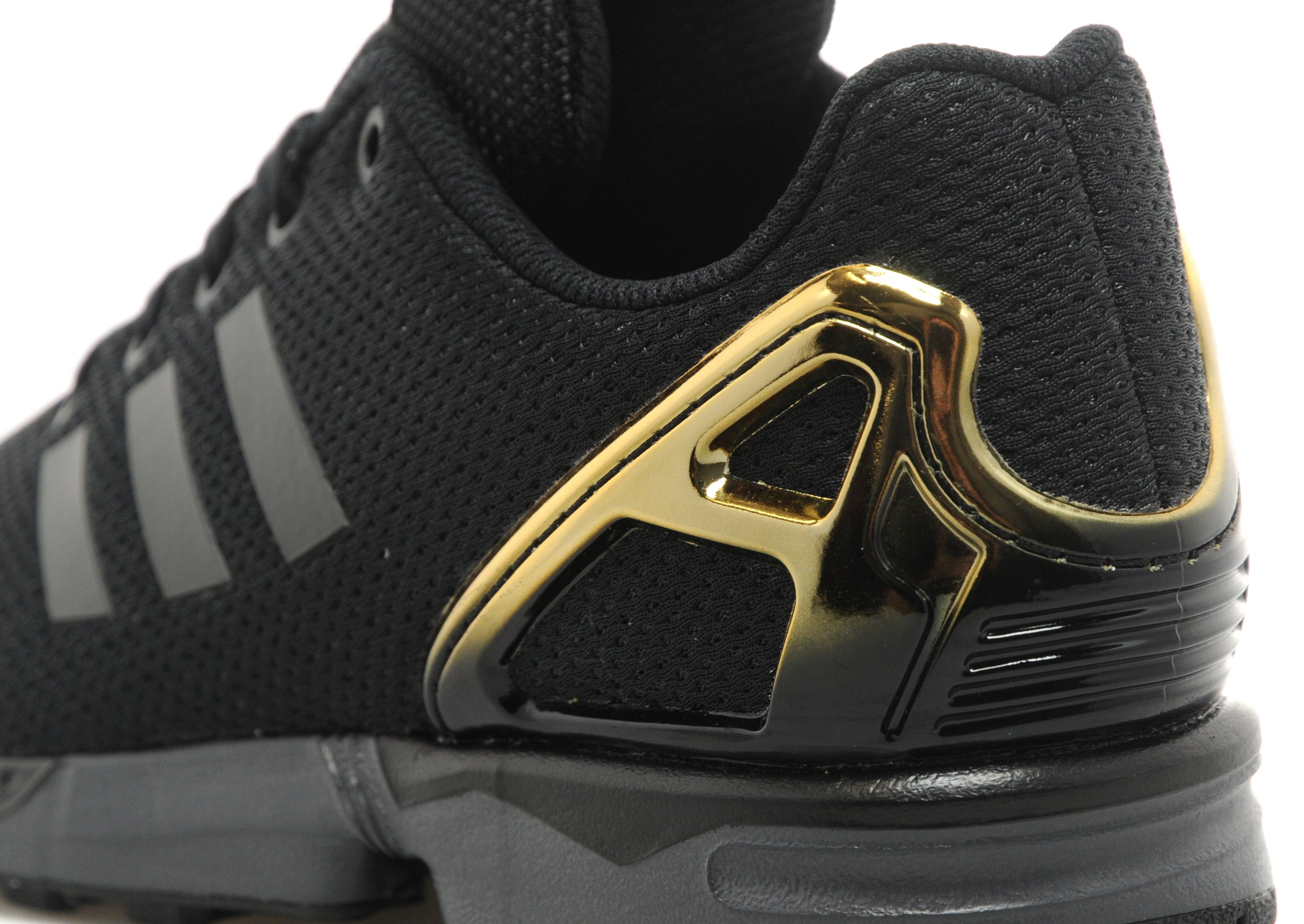 huge selection of 79fd0 2fd9c Adidas Zx Flux Black And Gold Jd