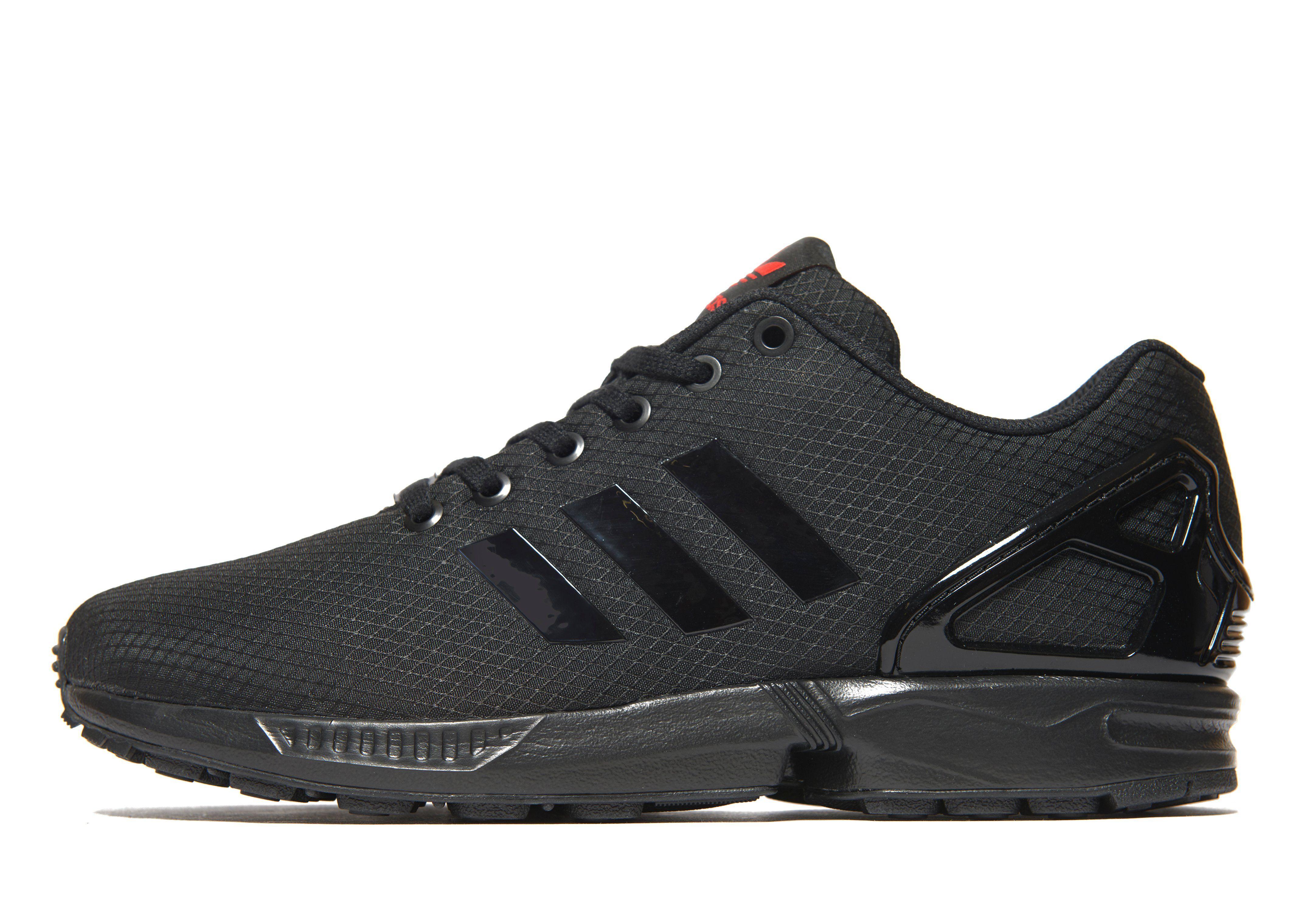 all black adidas trainers mens