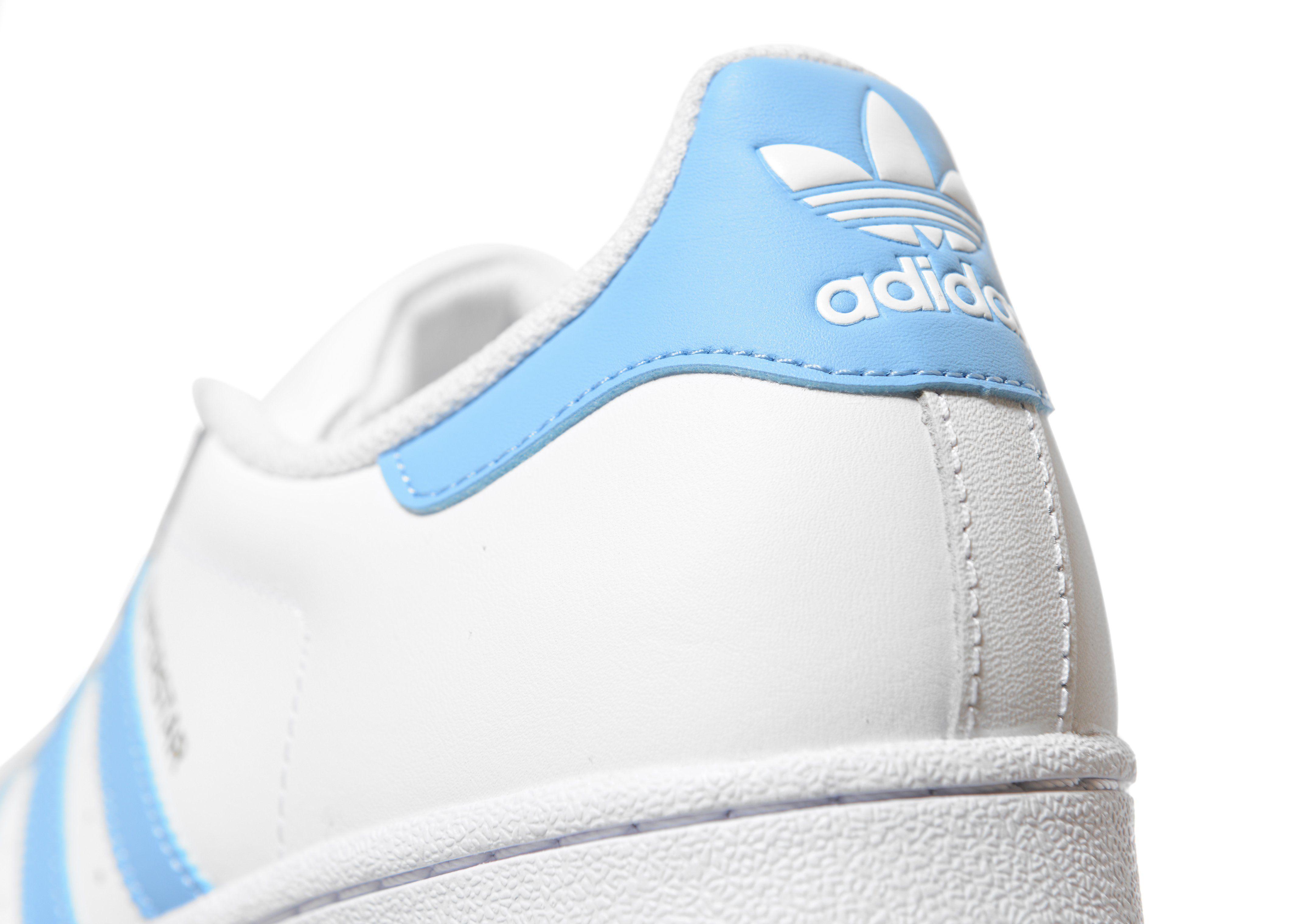 Adidas superstar due donne a cinghia rita o inchiostro blu