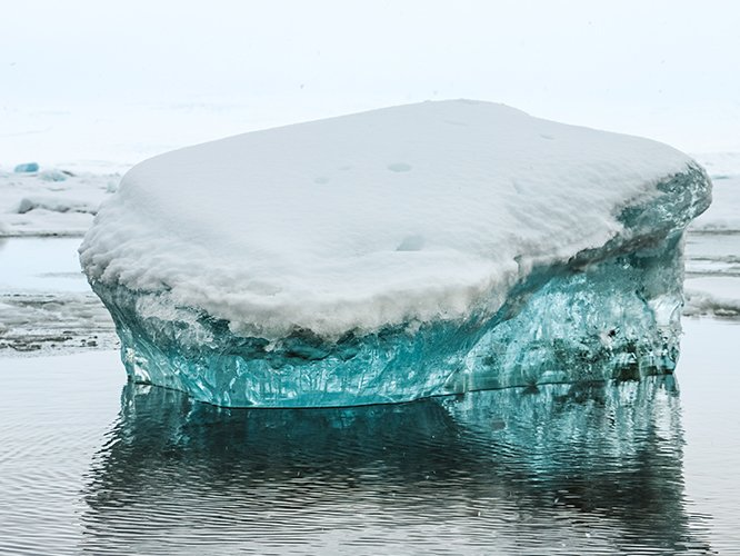 Melting iceberg in frozen lake