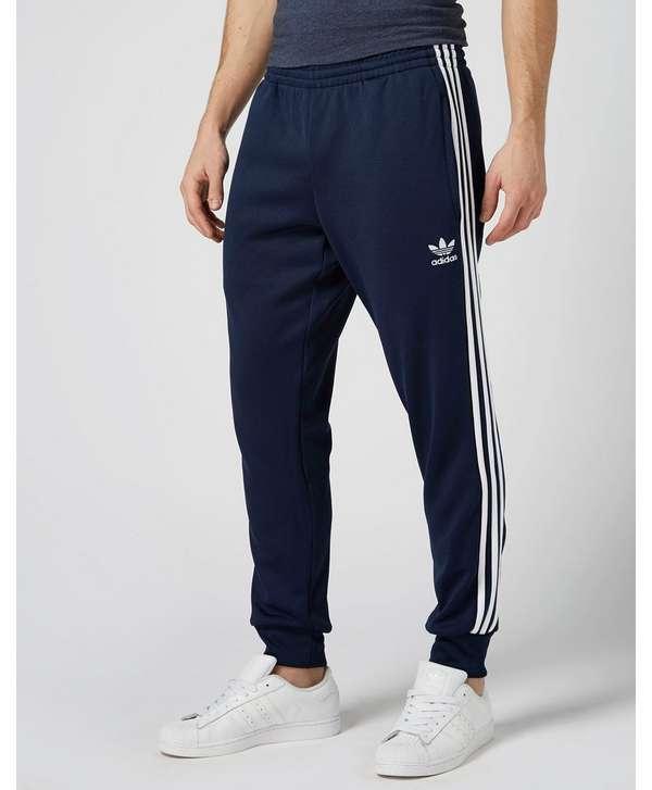 official photos cf91d c6c04 adidas Originals Superstar Cuffed Track Pants ...