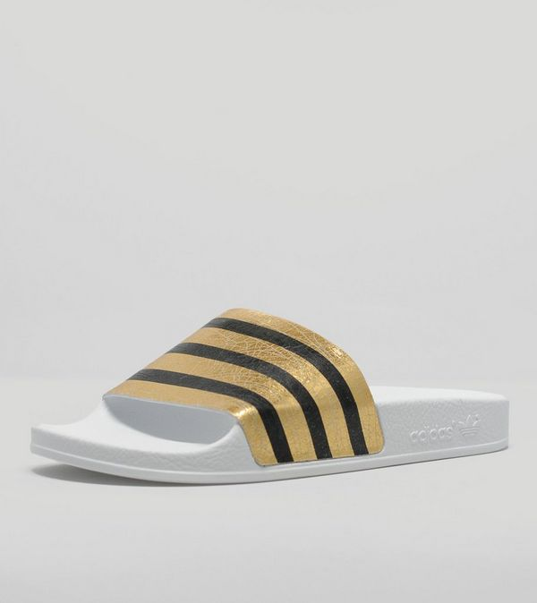 0be73ea99594c adidas Originals Adilette Gold Slides Women s