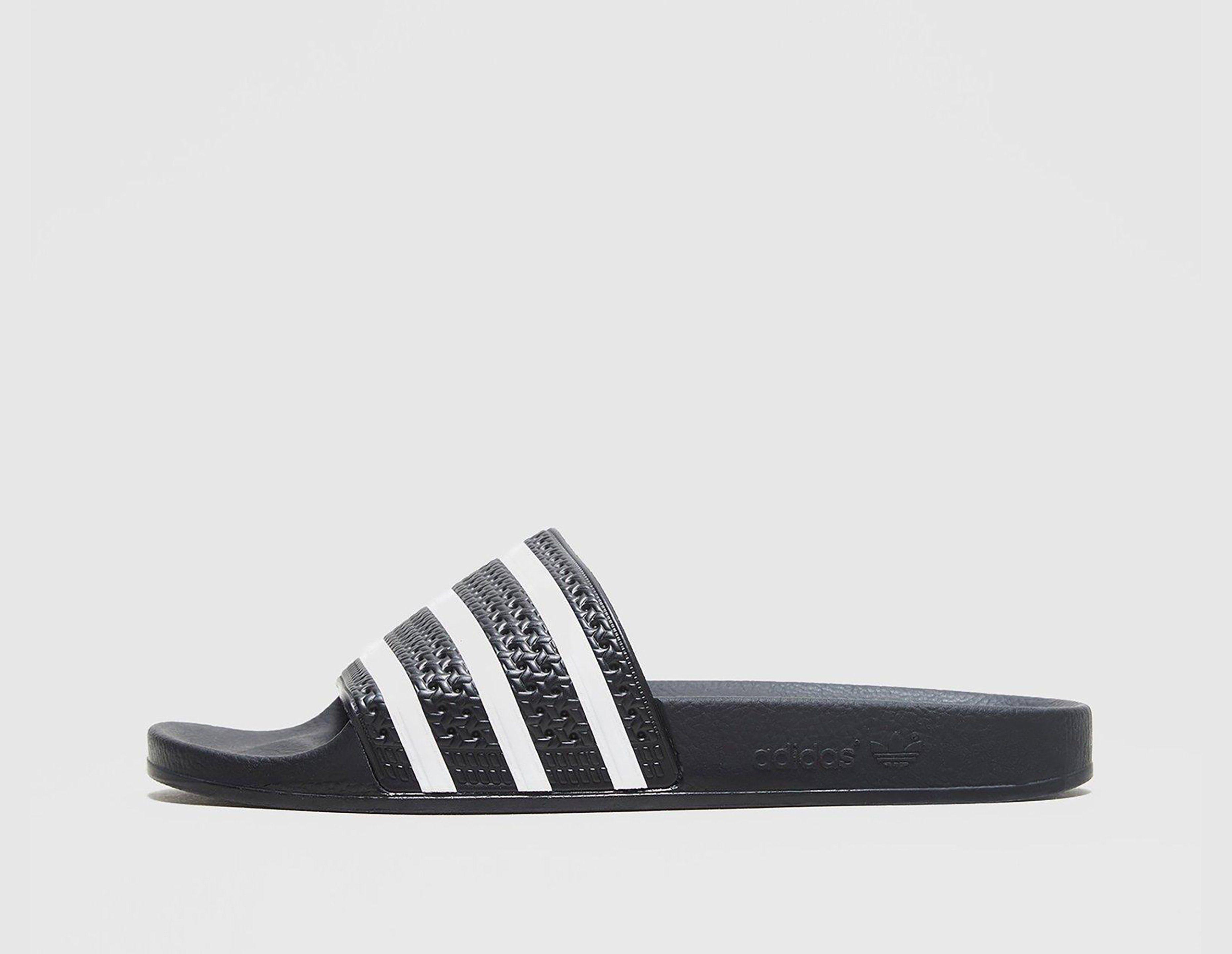b42e64e9a455 adidas Originals Adilette Slides Women s