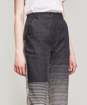 Li Striped Linen-Blend Trousers
