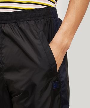 Phoenix Face Nylon Track Pants