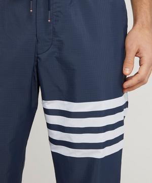 Engineered Stripe 4-Bar Ripstop Track Pants