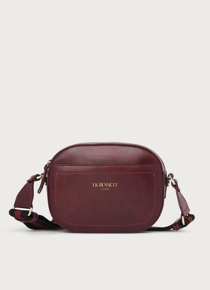 Maura Wine Leather Oval Crossbody Bag