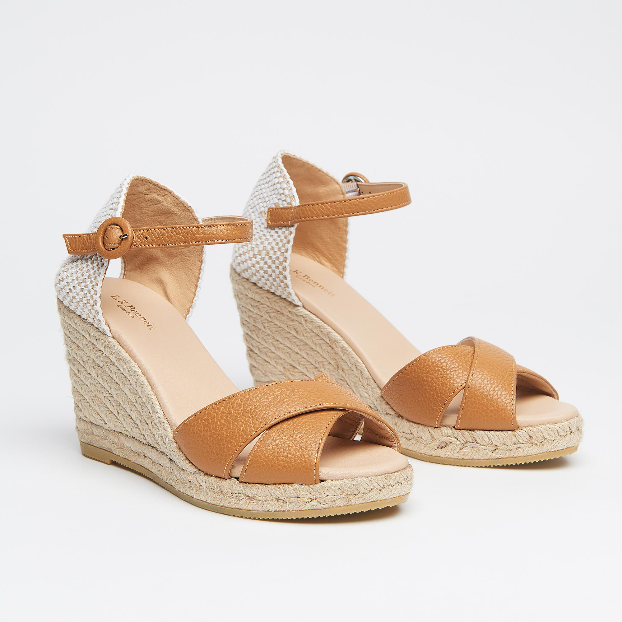 14e0a9caf19 Angele Tan Leather Sandals