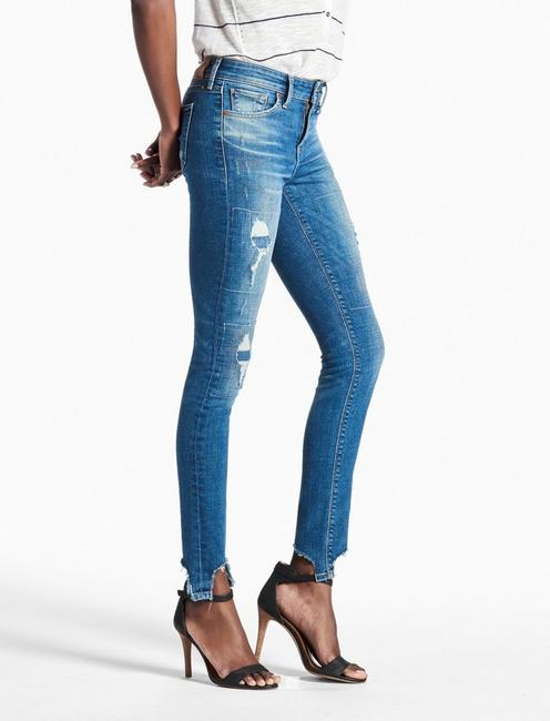 AVA MID RISE SKINNY JEAN WITH CHEWED HEM,