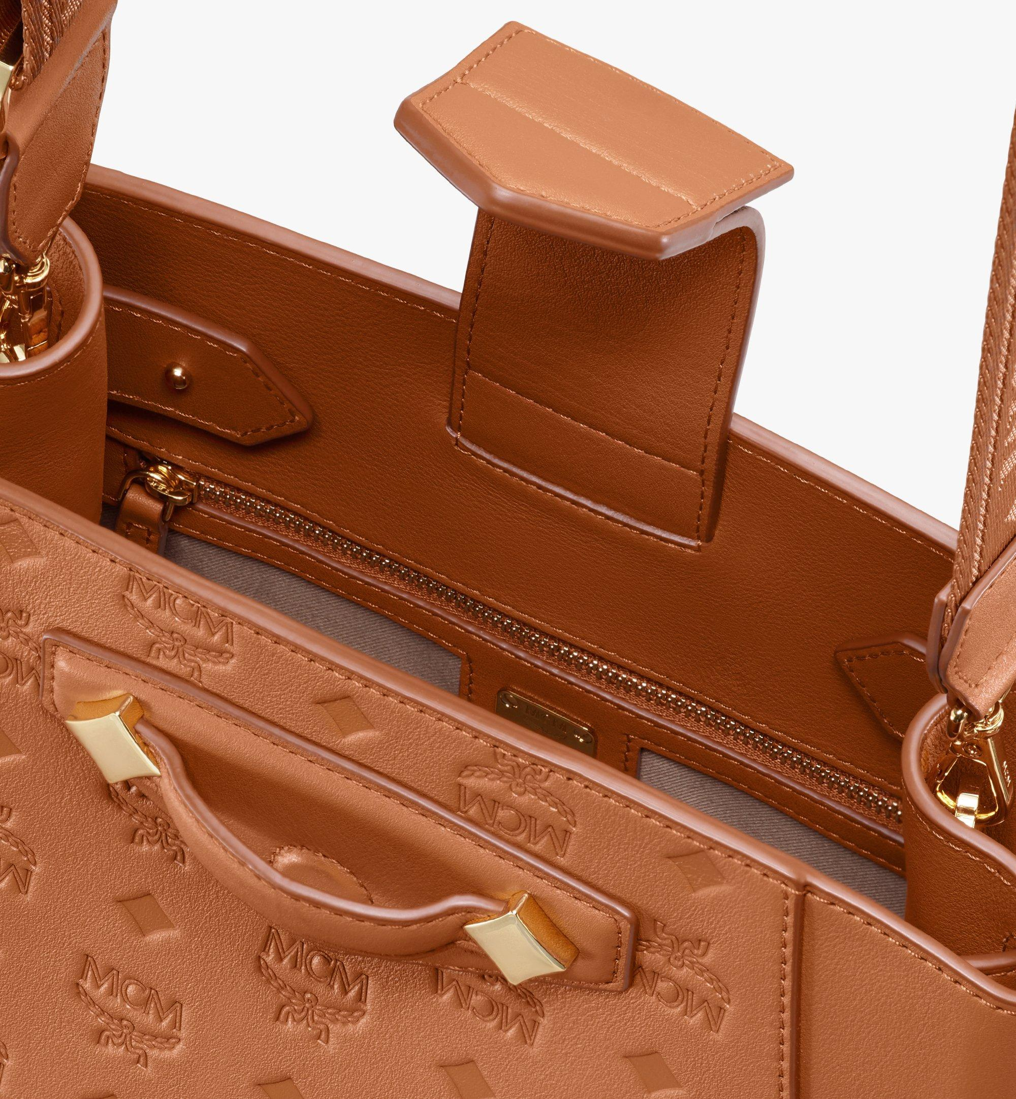 MCM Essential Beuteltasche aus Leder mit Monogramm Cognac MWDASSE04CO001 Alternate View 4