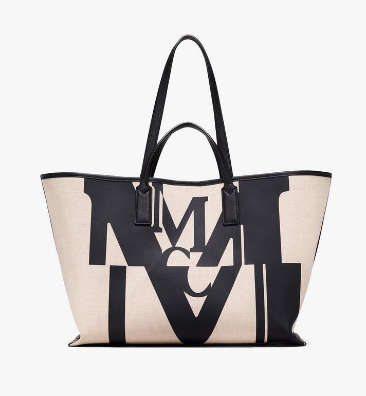MCM กระเป๋าช็อปเปอร์ผ้าใบลายโลโก้แต่งเอฟเฟคกลิทช์ Alternate View