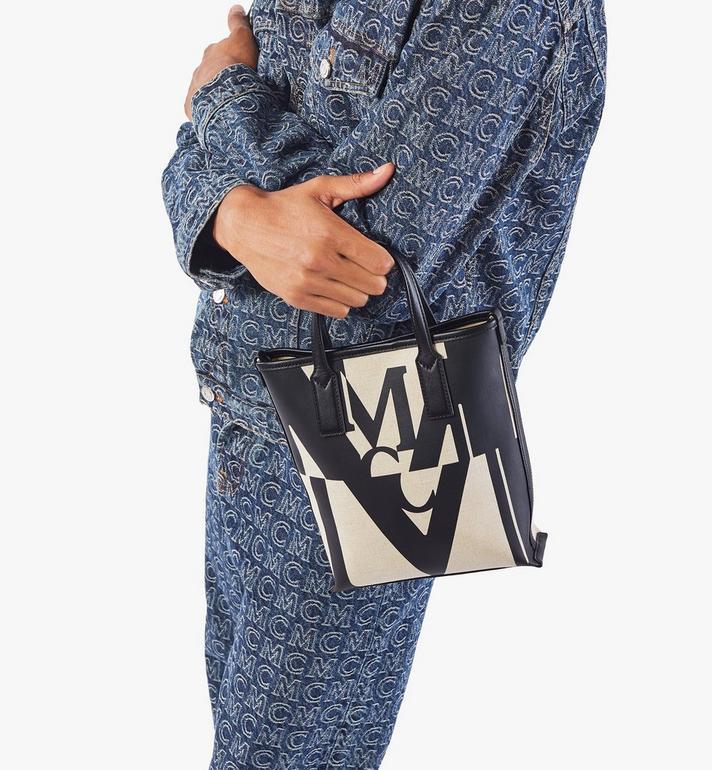 MCM กระเป๋าช็อปผ้าใบลายโลโก้แต่งเอฟเฟคกลิทช์ Black MWPAAMH02BK001 Alternate View 8