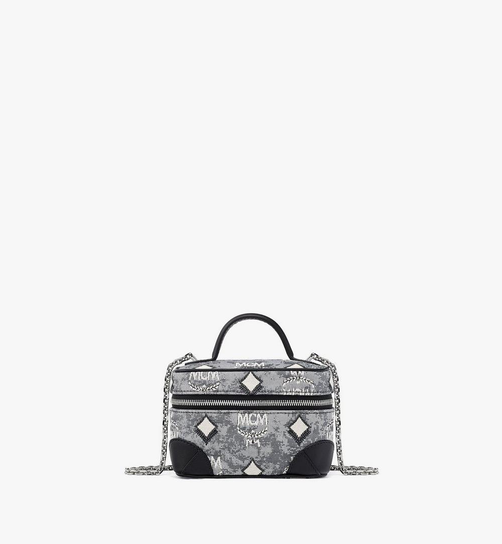 กระเป๋าเครื่องสำอางผ้าแจ็คการ์ดลายโมโนแกรมวินเทจ 1