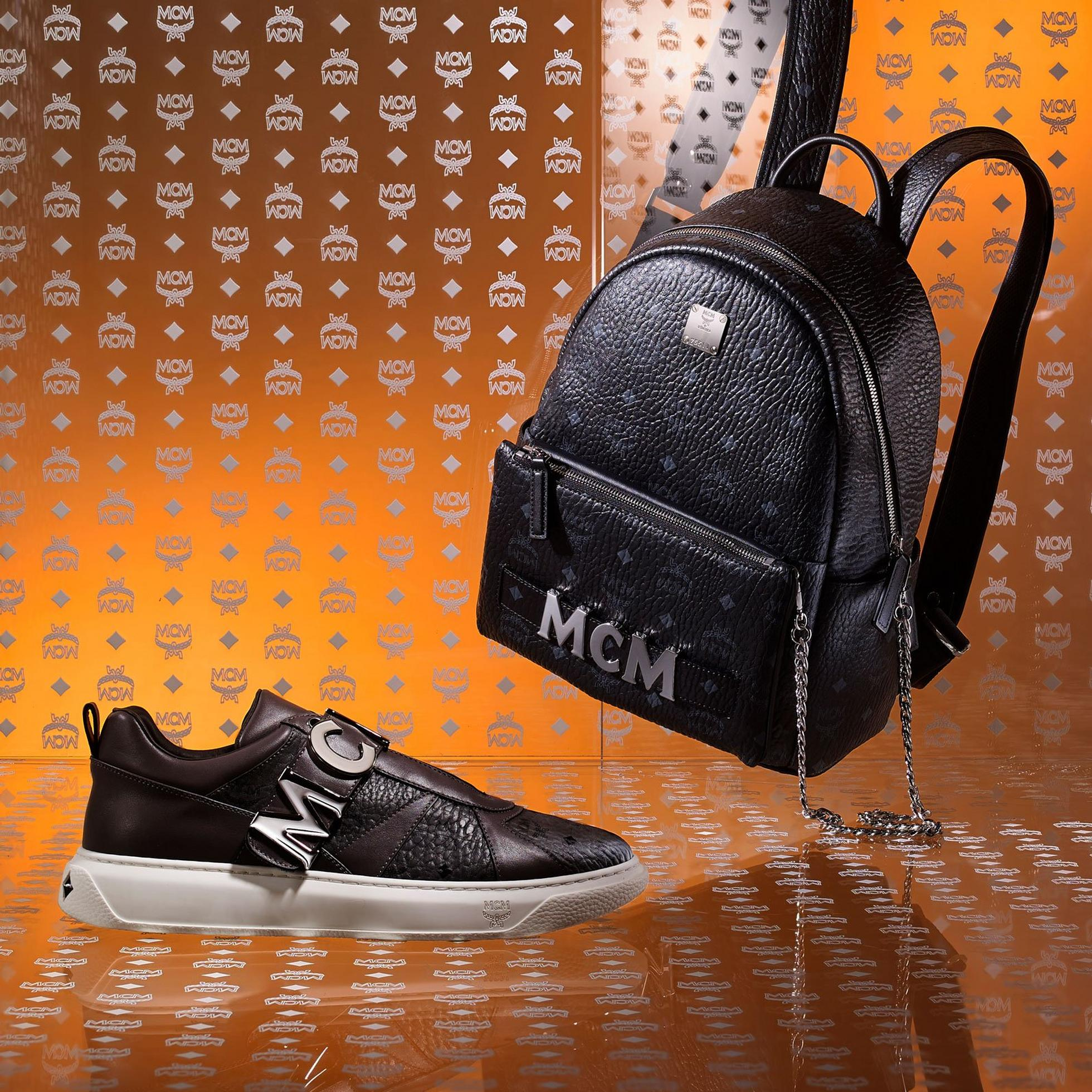Men's New Arrivals banner featuring Trilogie Stark Backpack and Big Logo Sneaker
