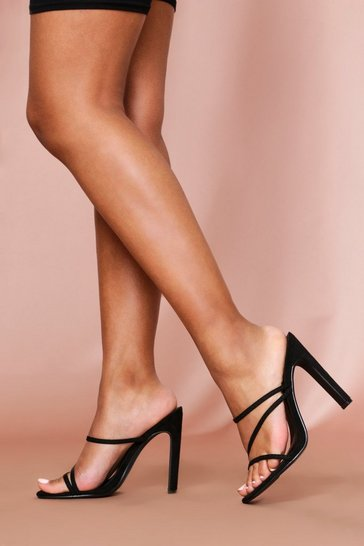 Black strappy flat heeled mules