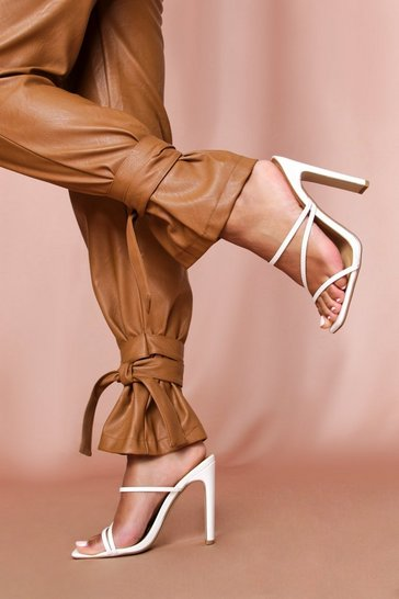 White strappy flat high heeled mules
