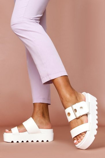 White cleated buckle detail heeled mules