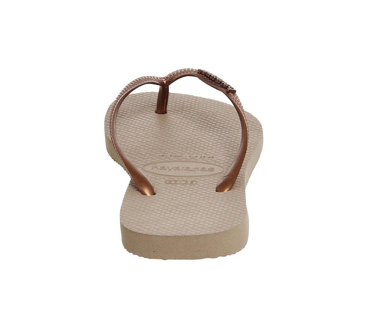 84e7d6356e76 Havaianas Slim Logo Metallic Flip Flops Copper - Sandals