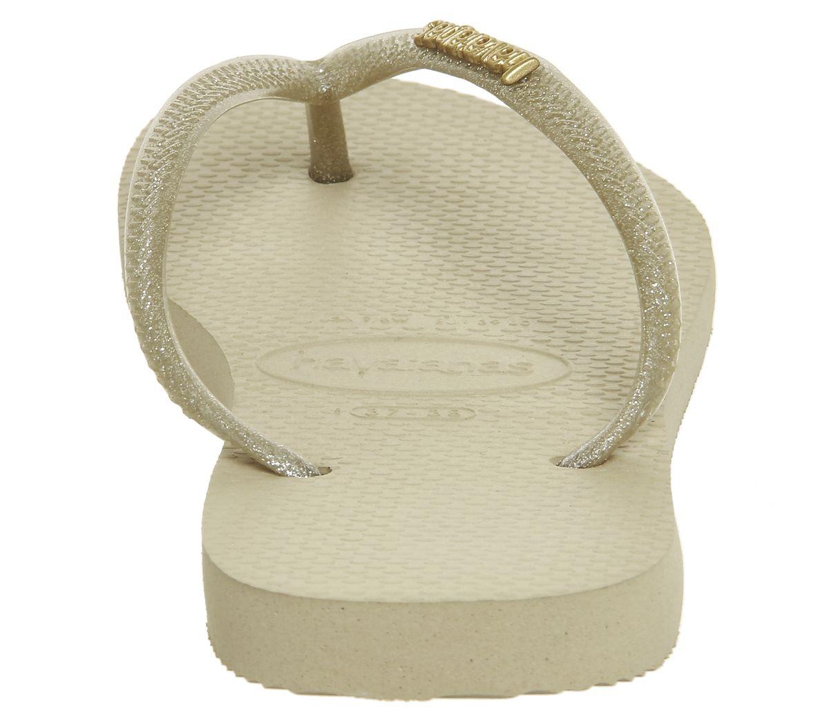 217b4356f34d Havaianas Slim Logo Metallic Flip Flops Light Gold - Sandals