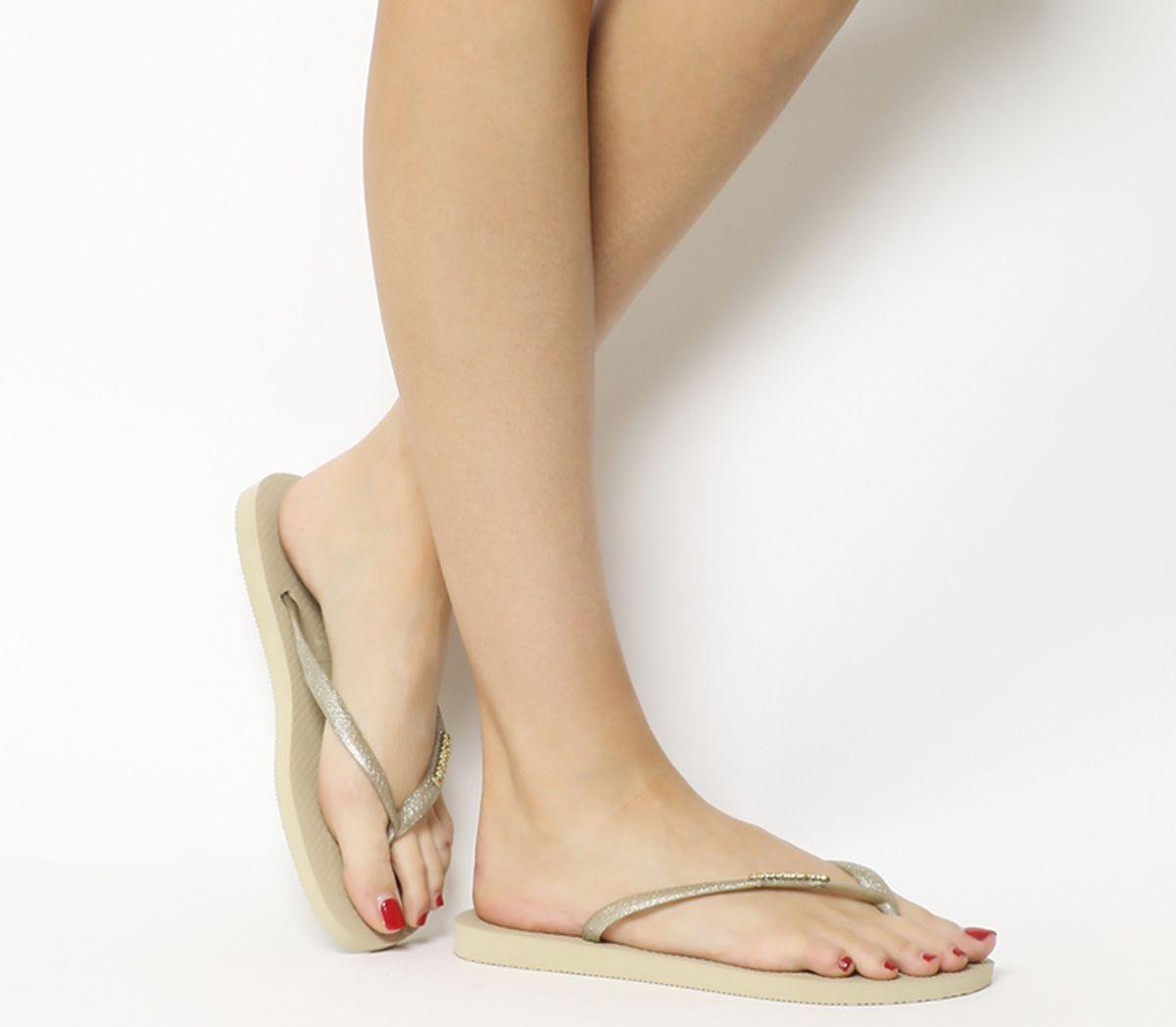 2a404ea75 Havaianas Slim Logo Metallic Flip Flops Light Gold - Sandals