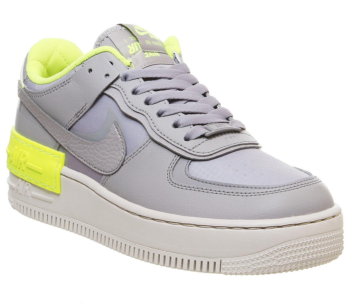 Nike Air Force 1 Shadow Trainers Atmosphere Grey Light Orewood Brown Volt Hers Trainers The low sneaker was realised in '83 (a year after the high top) and caught the attention of the sneakerhead community; offspring