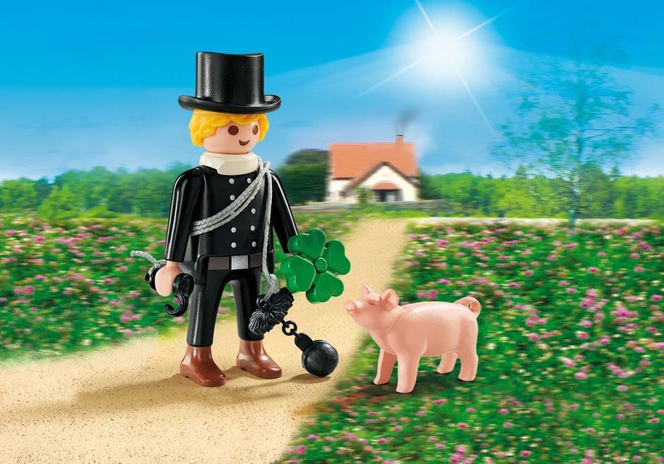 Schornsteinfeger mit Glücksschweinchen