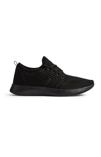 Schwarze Sneaker mit Prägung
