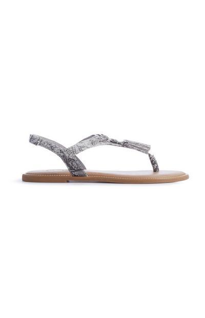 Sandalen mit Schlangenprint und Quaste