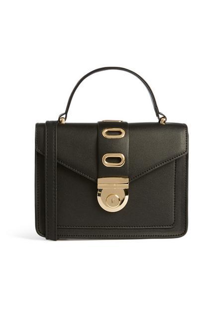 Schwarze Tasche mit goldener Schnalle