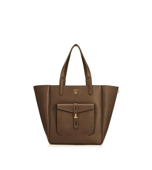 5ba15858bc HOLLYWOOD LEATHER MEDIUM T TWIST TOTE