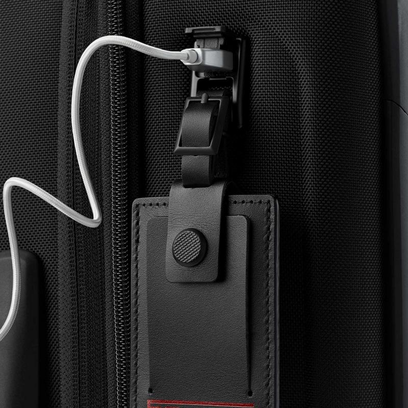 Tumi luggage detail of usb iPhone charger and tag.