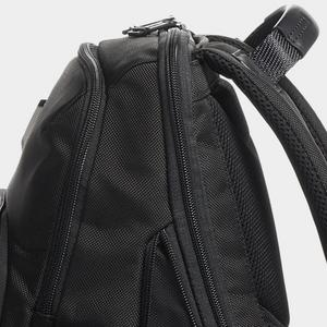 Detail of backpack showing construction of post-industrial nylon material.