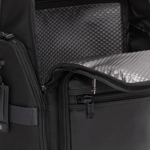 Interior detail of luggage backpack showing coating material construction.