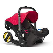 image of Doona+ Infant Car Seat and Stroller Travel System - Flame Red