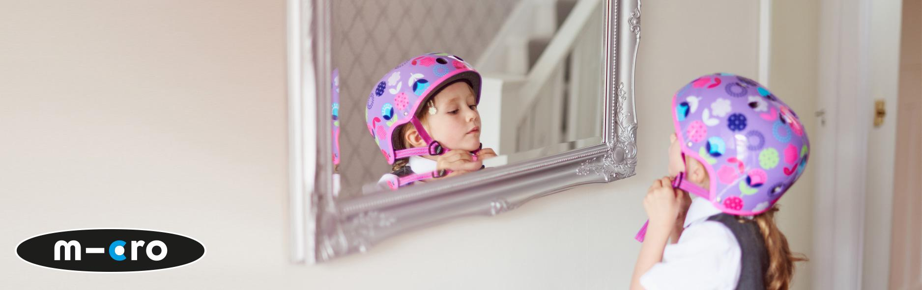 Child Staring At Mirror With Helmet