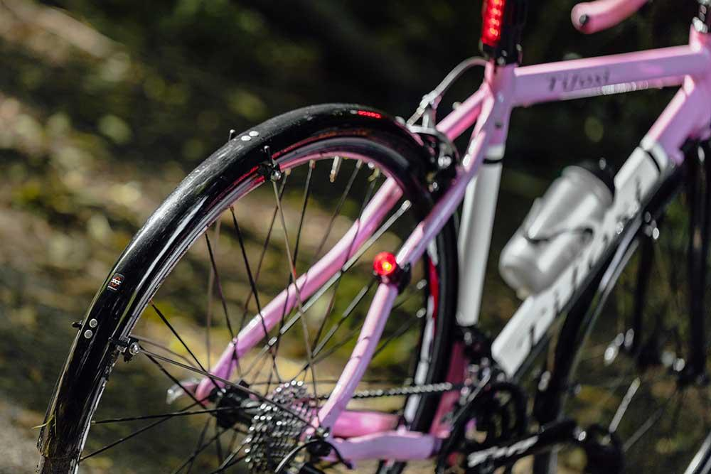 Pink Tifosi bike cropped and focused to highlight a rear mudguard fitted