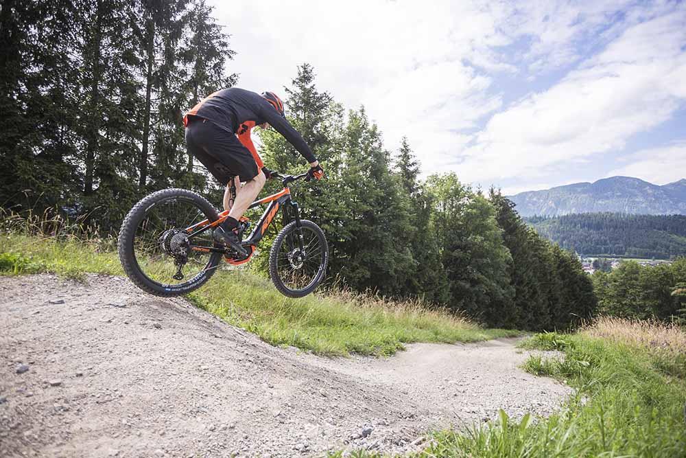 A rider catch some air on an e-MTB