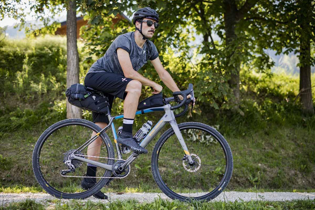A cyclist with a minimal bikepacking setup