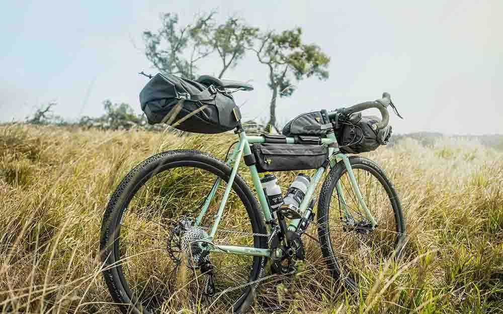 urly Straggler in mint green with a full set of bikepacking bags