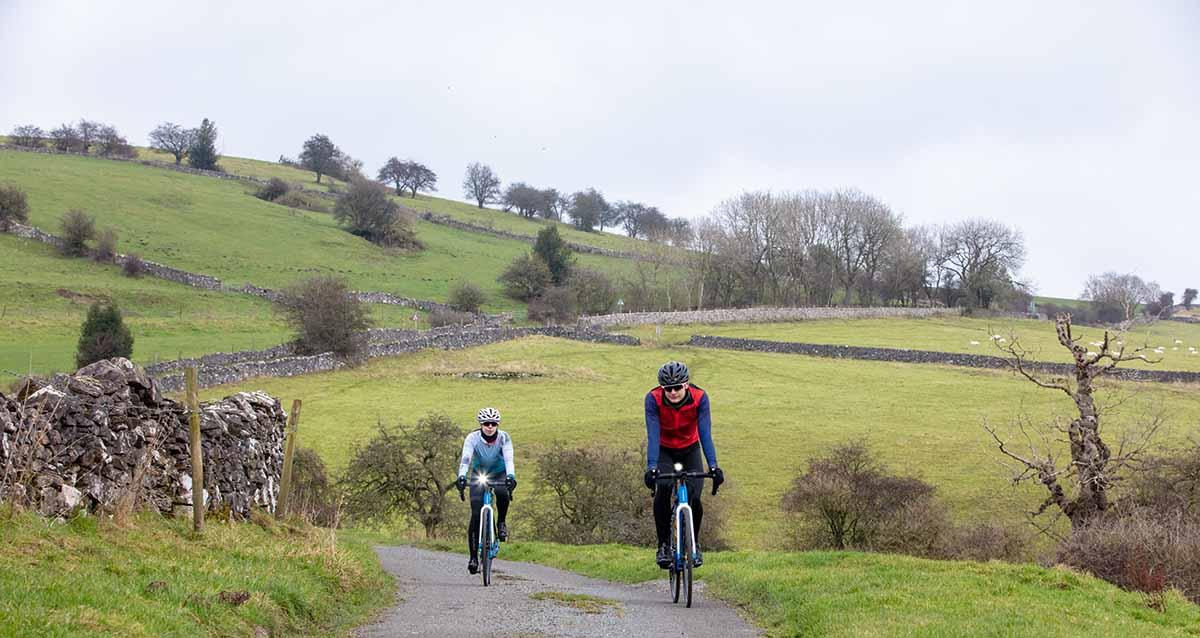Two riders on electric road bike