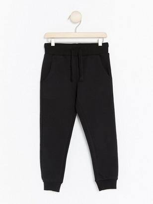 Teplákové kalhoty Černá