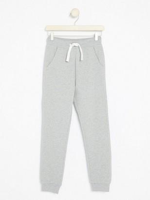 Teplákové kalhoty Šedivá