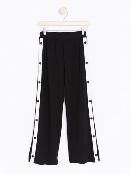 Široké kalhoty spatenty Bílá