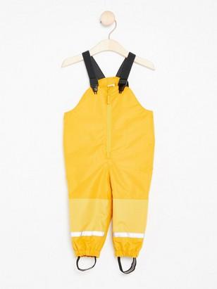 Žluté kalhoty do deště Žlutá