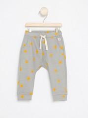 Vzorované kalhoty Žlutá