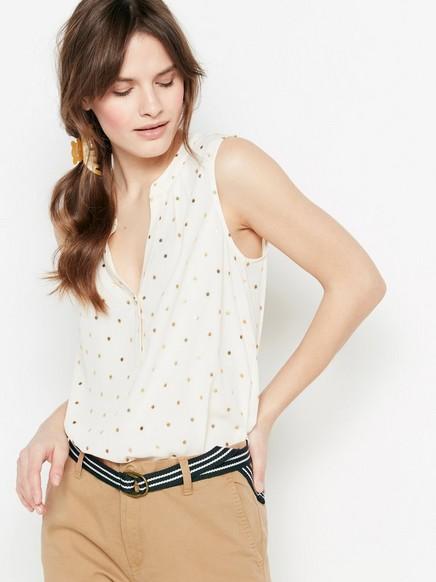 Ermeløs bluse med prikker Hvit