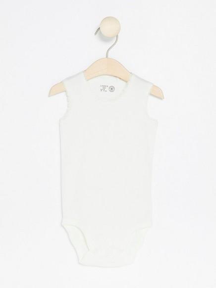 Ermeløs body med blonder Hvit
