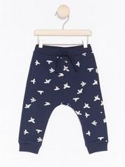 Volné kalhoty se vzorem ptáčků Modrá