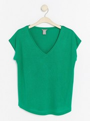 Topp med V-hals i lyocellblanding Grønn